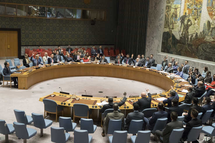 The United Nations Security Council votes on a new sanctions resolution that would increase economic pressure on North Korea to return to negotiations on its missile program at U.N. headquarters, Aug. 5, 2017.