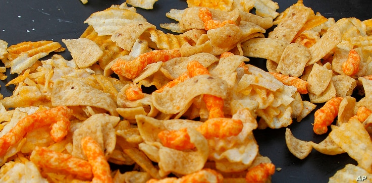 FILE - A mixture of salty snacks and chips is shown on a table in Pittsburgh's Market Square, Feb. 7, 2012.