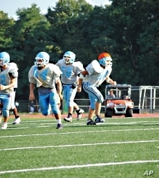 Rakin Hamad (middle, number 58) fasted during the last three football seasons but decided not to this year due to the extreme heat.