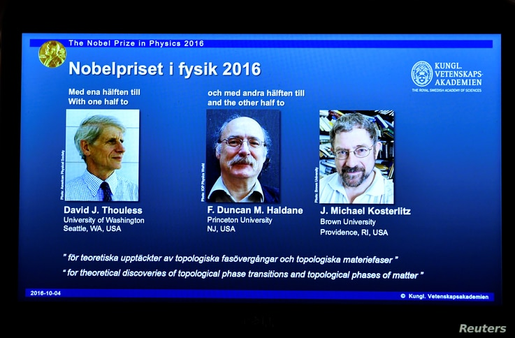 A screen showing pictures of the winners of the 2016 Nobel Prize for Physics during a news conference by the Royal Swedish Academy of Sciences in Stockholm, Sweden, Oct. 4, 2016.