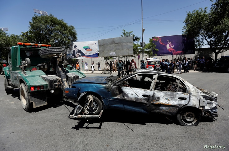 A damaged car is moved away after a blast in Kabul, Afghanistan May 31, 2017.