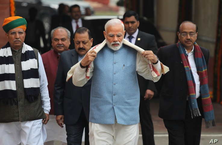 FILE - Indian Prime Minister Narendra Modi, center, arrives with his cabinet colleagues on the opening day of the budget session of the Indian Parliament, in New Delhi, Jan. 31, 2019.