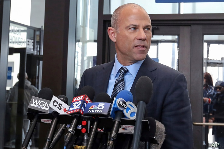 Attorney Michael Avenatti, who is representing an alleged R. Kelly victim, speaks to reporters at the Leighton Criminal Courthouse in Chicago after the R&B singer entered a not guilty plea to all 10 counts of aggravated criminal sexual abuse, Feb. 25...