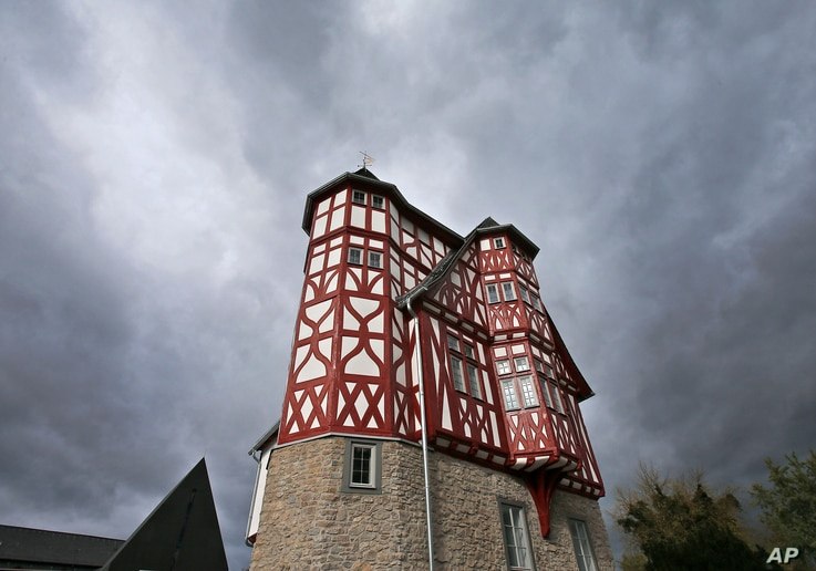 FILE - Dark clouds hang over the controversial residence built by Bishop Franz-Peter Tebartz-van Elst in Limburg, Germany.