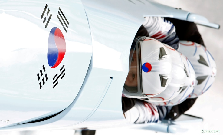 South Korea's pilot Kim Dong-hyun (front) and his teammates speed down the track during a four-man bobsleigh training session at the Sanki Sliding Center in Rosa Khutor, during the Sochi 2014 Winter Olympics near Sochi, February 20, 2014.            ...