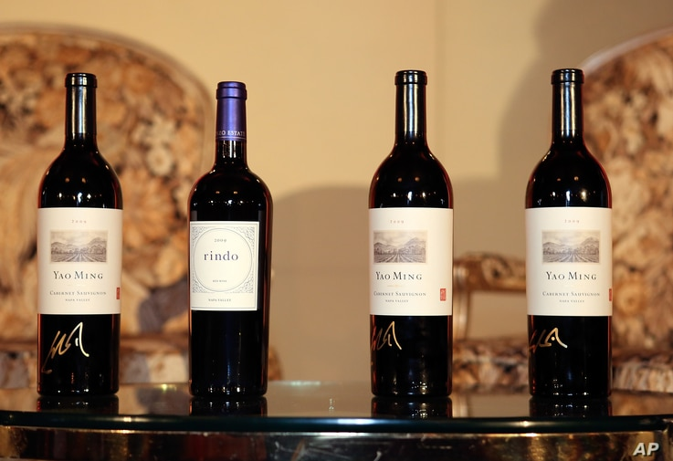 FILE - Yao Family Wine bottles are seen at the Millennium Biltmore Hotel in Los Angeles, California, Feb. 19, 2013.