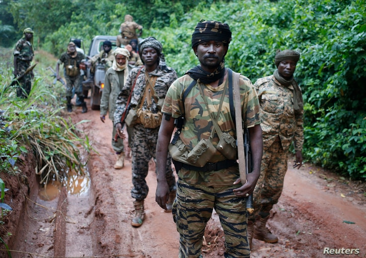 Seleka General Zakariya Isa Chamchaku patrols with other fighters as they search for Anti-Balaka Christian militia members near town of Lioto, Central African Republic, June 6, 2014.