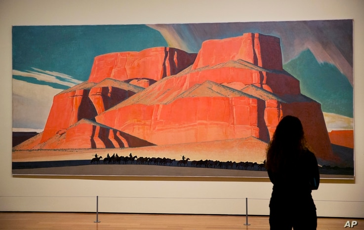 "Maynard Dixon's 1935 painting ""Red Butte with Mountain Men"" is displayed in the exhibit ""Cross Country: The Power of Place in American Art, 1915-1950,"" at the High Museum of Art in Atlanta, Feb. 6, 2017."