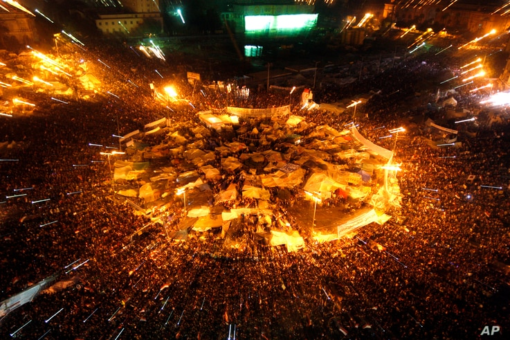 Egyptians celebrate after President Hosni Mubarak resigned and handed power to the military at Tahrir Square, Feb. 11, 2011.