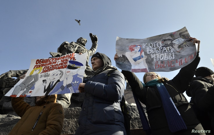 Supporters of Russian opposition leader Alexei Navalny attend a rally for a boycott of a March 18 presidential election in the far eastern city of Vladivostok, Russia, Jan. 28, 2018.