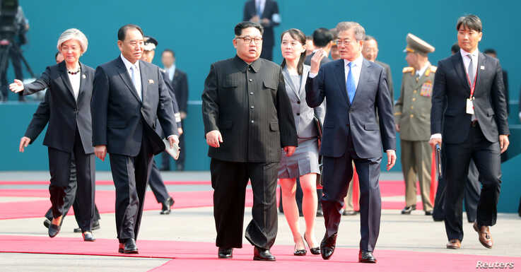 South Korean President Moon Jae-in and North Korean leader Kim Jong Un arrive at the Peace House in the truce village of Panmunjom inside the demilitarized zone separating the two Koreas, South Korea, April 27, 2018.