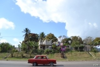 Colorful homes are common throughout Havana, and beyond, such as in this neighboring village.