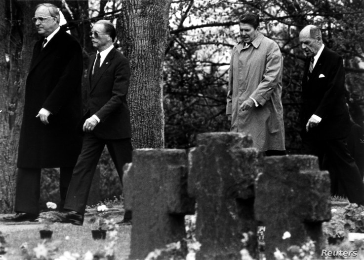FILE German Chancellor Helmut Kohl walks with retired German Air Force General Johannes Steinhoff (frt) and former President Ronald Reagan accompanied by retired U.S. General Matthew Ridgway through the German military cemetary in Bitburg, May 5 1985...