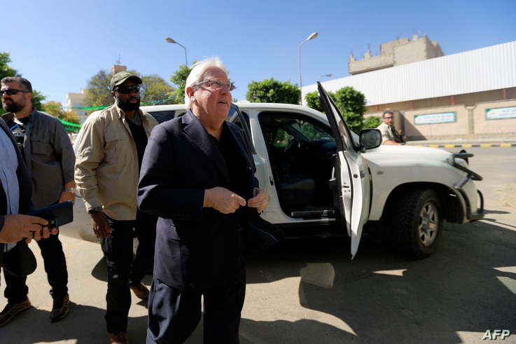U.N. envoy to Yemen Martin Griffiths (C) arrives for a meeting with the President of the Huthi Revolutionary Committee, in the capital Sana'a, Nov. 24, 2018.