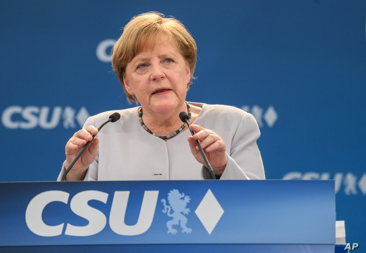 German Chancellor Angela Merkel delivers a speech during a joint campaigning event of the Christian Democratic Union (CDU) and the Christion Social Union (CSU) in Munich, May 27, 2017.