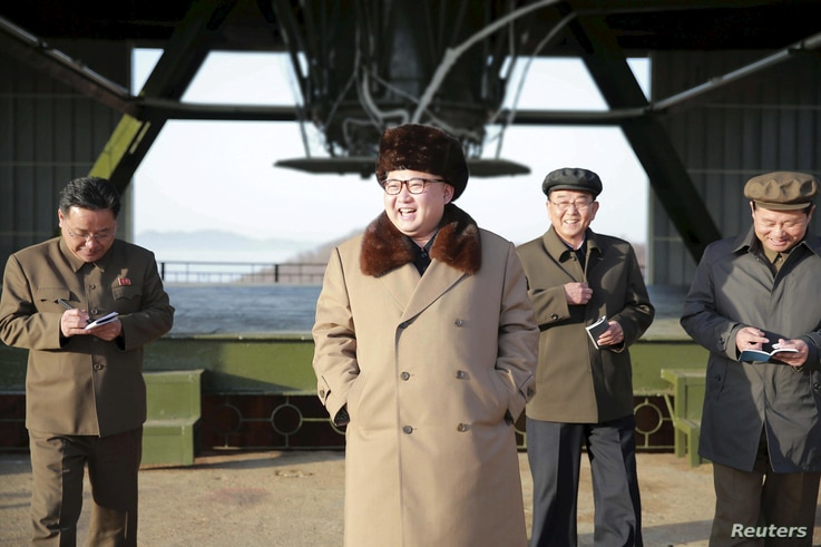 FILE - North Korea leader Kim Jong Un smiles as he visits Sohae Space Center in Cholsan County, North Pyongan province for the testing of a new engine for an intercontinental ballistic missile in this undated photo released by North Korea's Korean Ce...