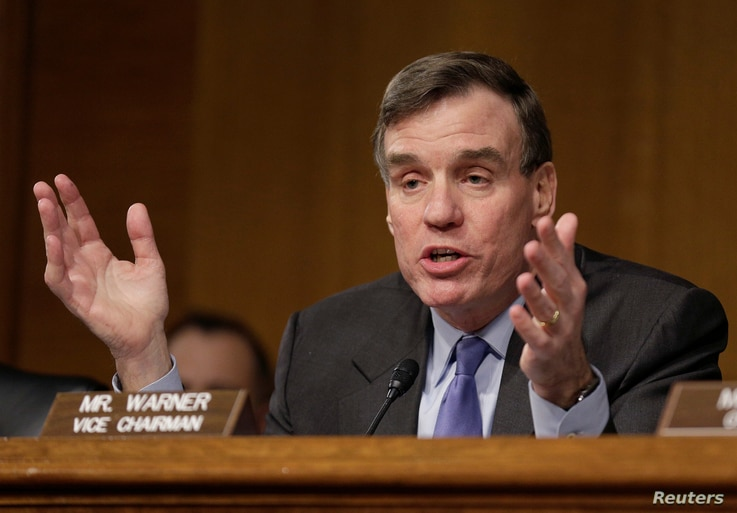 Senator Mark Warner, D-VA, questions witnesses during a Senate Select Committee on Intelligence hearing on Russia's intelligence activities on Capitol Hill in Washington, D.C., Jan. 10, 2017.