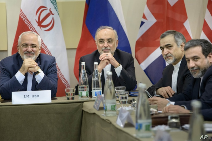 Iranian Foreign Minister Javad Zarif, left, Head of Iranian Atomic Energy Organization Ali Akbar Salehi, second left, Special Assistant to Iranian president Hossein Fereydoun, second right, and Iranian Deputy Foreign Minister Abbas Araghchi wait for ...