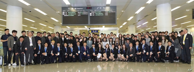 Members of South Korean Art Troupe and Taekwondo demonstration team pose upon their arrival at the Pyongyang Airport in Pyongyang, North Korea, Saturday, March 31, 2018.