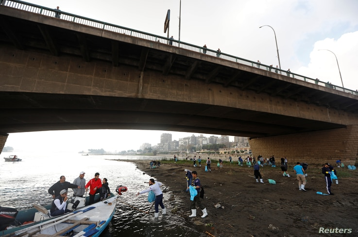 Egyptian youth volunteers collect waste and plastic as part of a campaign to clean up the Nile River sponsored by Egypt's environment ministry in cooperation with VeryNile and Greenish, in Cairo, Egypt, Feb. 10, 2019.