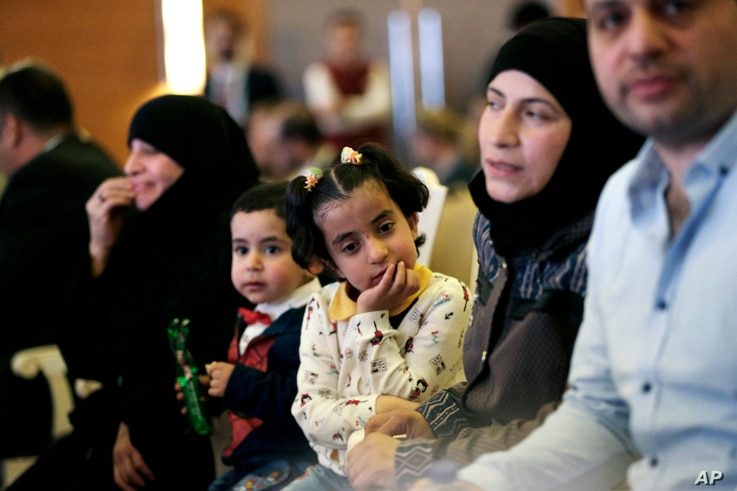 Syrian refugees attend the launch of an education program in Ankara, Turkey, June 8, 2017. Turkey, the European Union and UNICEF  formally launched an EU-funded project to encourage Syrians and other refugees in Turkey to enroll their children in sch...