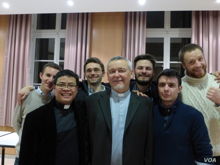 Reverend Georges Colomb with priests from the Roman Catholic Foreign Missions Society of Paris. (Lisa Bryant for VOA)