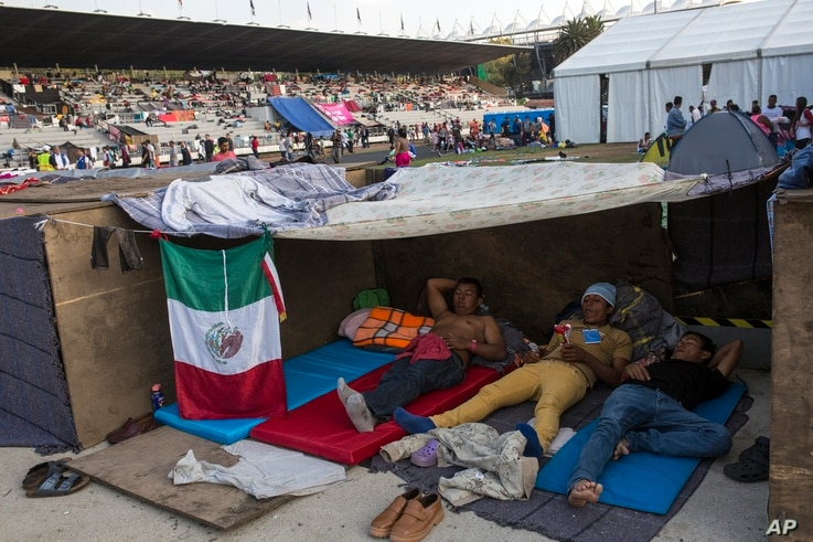 Central American migrants rest at the Jesus Martinez stadium in Mexico City, Nov. 6, 2018. Humanitarian aid converged around the stadium in Mexico City where thousands of Central American migrants winding their way toward the United States were resti...