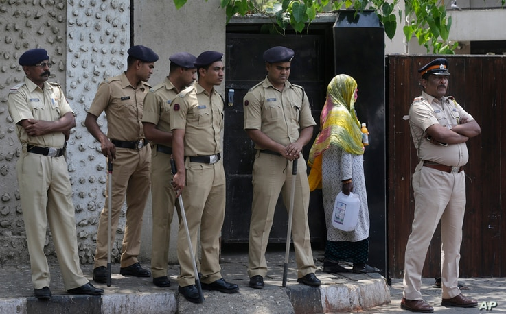 Policemen stand guard outside the house of Bollywood star Salman Khan in Mumbai, India, April 5, 2018.