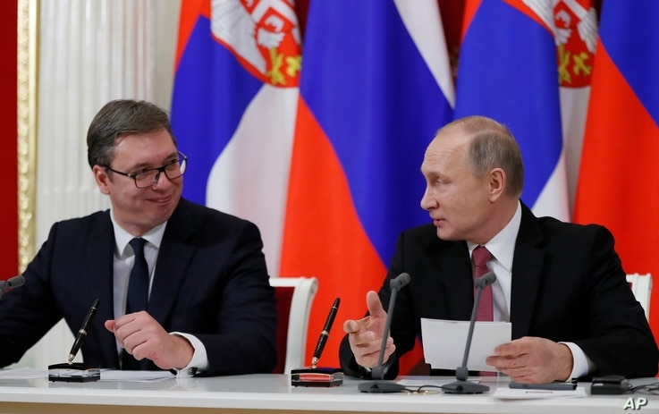FILE - Russian President Vladimir Putin (R) and Serbian President Aleksandar Vucic talk to each other during a meeting with the media following their talks in the Kremlin in Moscow, Russia, Dec. 19, 2017.