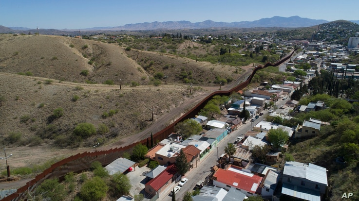 A photo made with a drone shows the U.S.-Mexico border fence cuts through the two downtowns of Nogales, April 2, 2017.