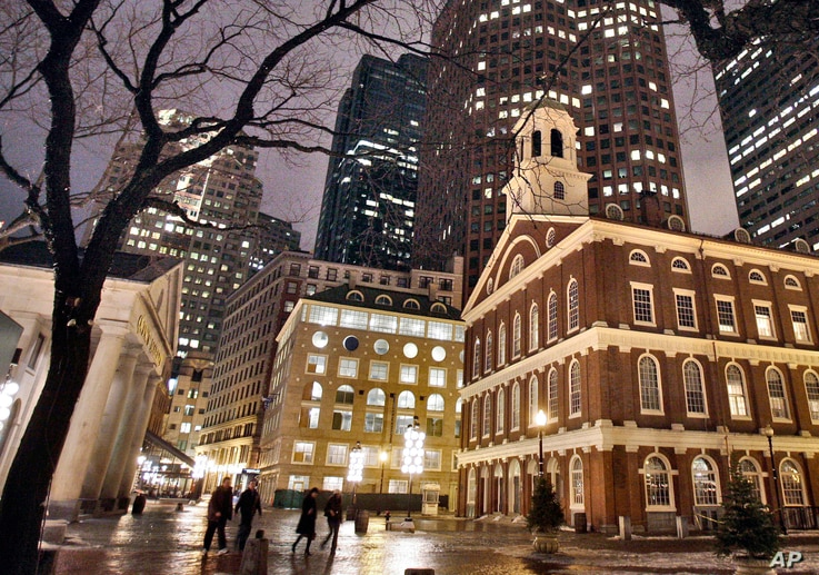 FILE - Faneuil Hall, right, is one of the sites on Boston's Freedom Trail. Rising seas around the world are putting such historic structures and coastal heritage sites under threat.