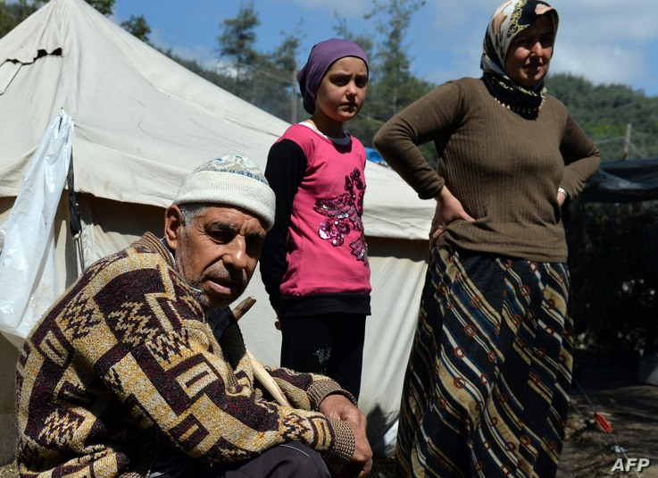 FILE - Syrian Turkmen are seen at a make-shift refugee camp some kilometers away from the Syria-Turkey border, Apr. 23, 2013.