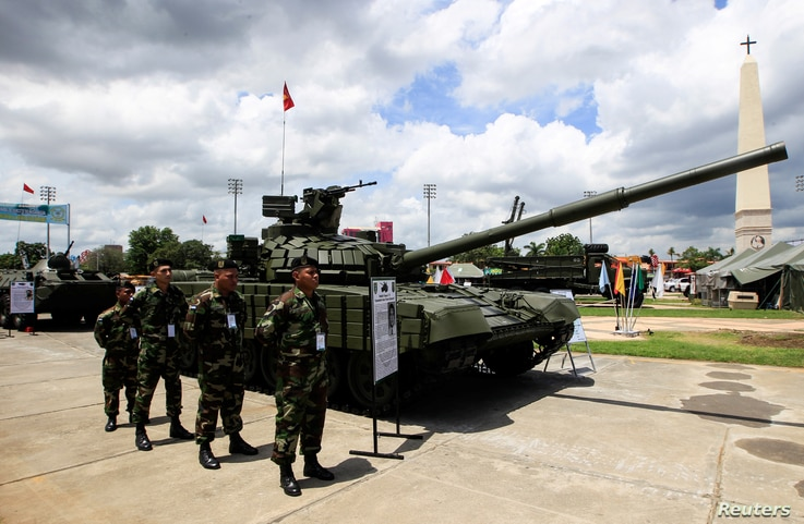 Members of Nicaragua's Army stand next to Russian-made T-72B Tank in Managua