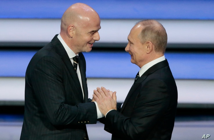 FIFA president Gianni Infantino, left, and Russian President Vladimir Putin shakes hands at the 2018 soccer World Cup draw in the Kremlin in Moscow, Dec. 1, 2017.