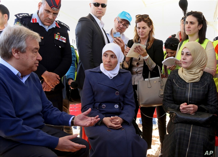 U.N. Secretary-General Antonio Guterres speaks to refugees during a visit the U.N.-run Zaatari camp for Syrian refugees, in northern Jordan, March 28, 2017. Guterres is to attend an annual Arab summit in Jordan on March 29.