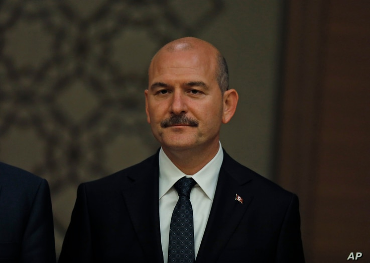 Suleyman Soylu, Turkey's Interior Minister. listens to President Recep Tayyip Erdogan, presenting his new cabinet during a news conference at Presidential Palace, in Ankara, Turkey, July 9, 2018.