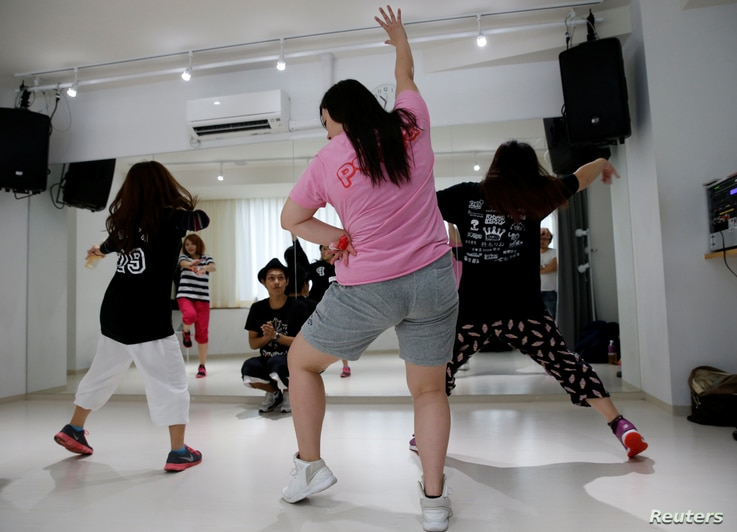Members of pop group Pottya practise their dance moves with an instructor at a studio in Tokyo, Japan, Dec. 5, 2016.