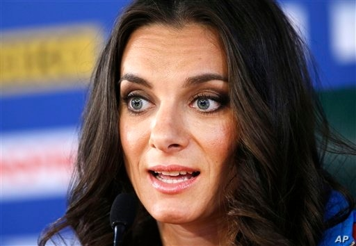 Russia's Yelena Isinbayeva, the gold medalist in the women's pole vault,  speaks during a press conference at the World Athletics Championships in the Luzhniki stadium in Moscow, Russia, Thursday, Aug. 15, 2013.   (AP Photo/Alexander Zemlianichenko)