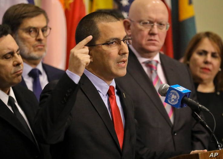Venezuela Foreign Affairs Minister Jorge Arreaza, speaks during a press conference, is surrounded by supporting diplomats from 16 countries including Russia, China, Iran and Syria, at U.N. headquarters, Feb. 14, 2019.