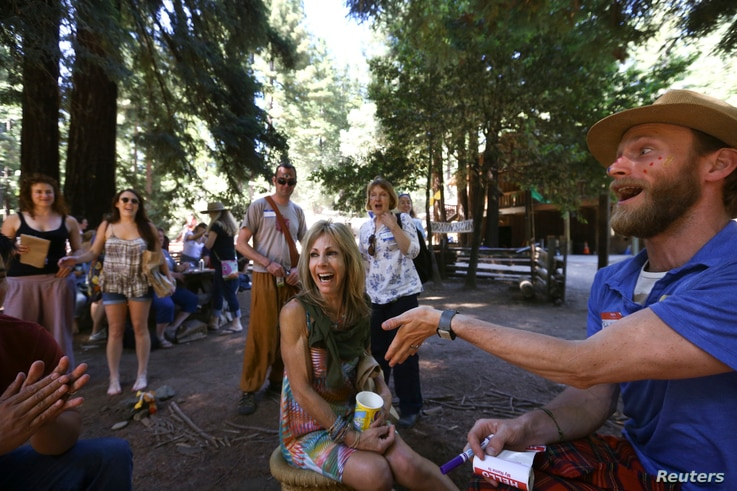 A camper smiles as a staffer announces her camp nickname at Camp Grounded in the Navarro, California, June 20, 2014.