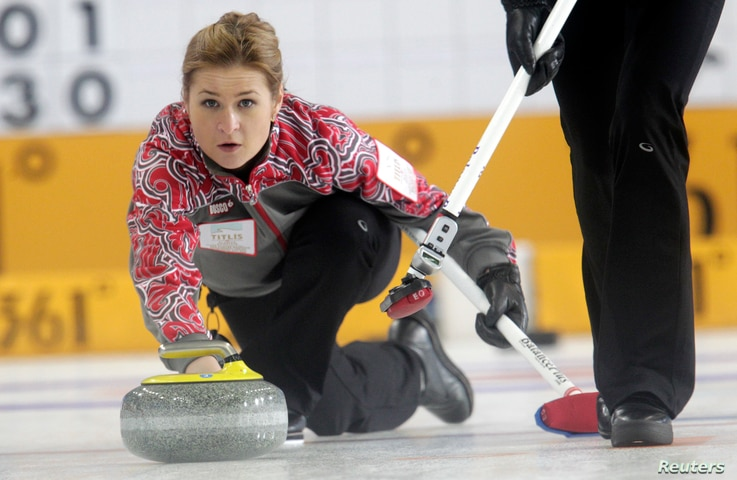Russia's second Margarita Fomina watches a stone during their World Women's Curling Championship qualification round match against Japan in Riga.