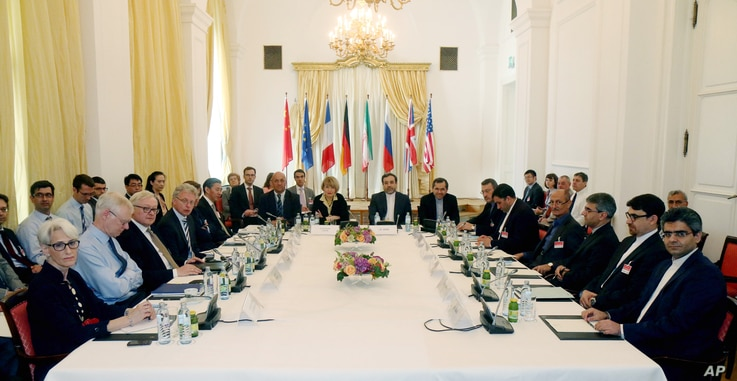 Delegates particpate in a bilateral meeting as part of the closed-door nuclear talks with Iran at a hotel in Vienna, Austria, June 12, 2015.