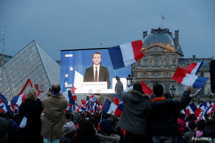 President-elect Emmanuel Macron is seen on a giant screen near the Louvre museum after results were announced in the second round of voting in the 2017 French presidential elections, in Paris, France, May 7, 2017.