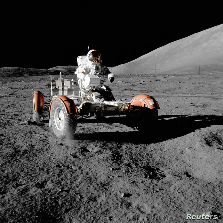 NASA astronaut Gene Cernan drives the lunar rover on the moon during the Apollo 17 mission, Dec. 11, 1972.