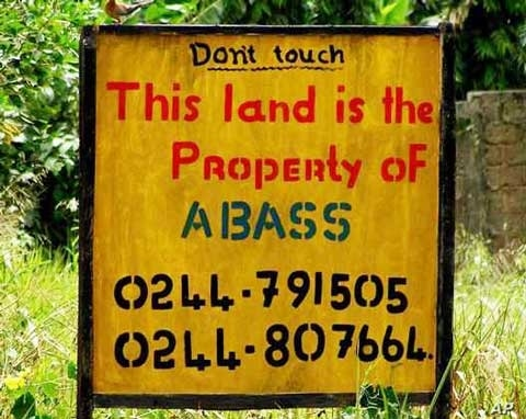 A sign marks private property in Angola.