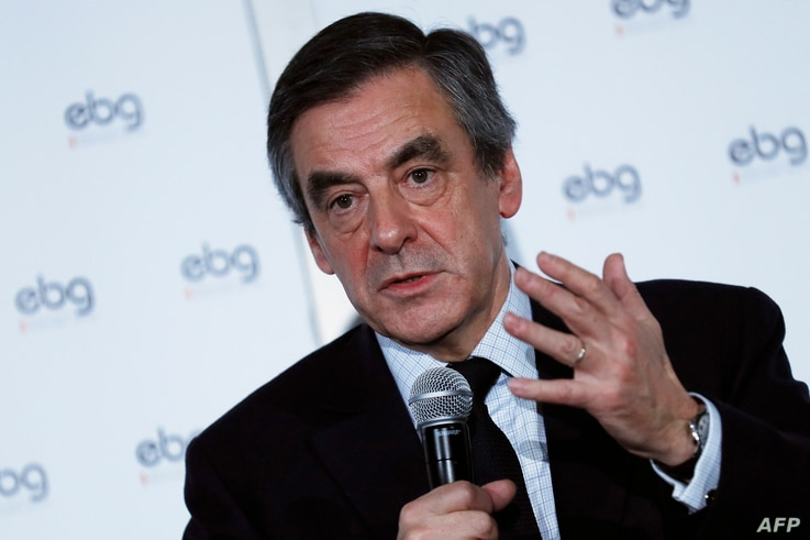 French presidential election candidate for the right-wing Les Republicains (LR) party Francois Fillon gestures as he speaks during a debate organized by the EBG (Electronic Business Group), Jan. 31, 2017, in Paris.