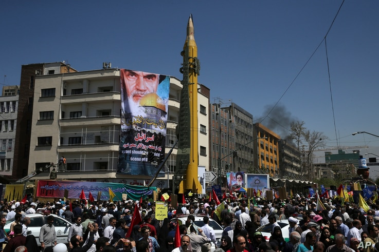FILE - A ballistic missile is displayed by Iran's Revolutionary Guard at a pro-Palestinian rally marking Al-Quds (Jerusalem) Day, in Tehran, Iran, June 23, 2017.