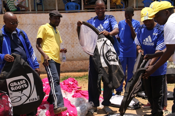 Coaches for the Malawi's Girls Grassroots Football program are seen getting ready to train a group of girls, in Zomba, Malawi. (L. Masina/VOA)