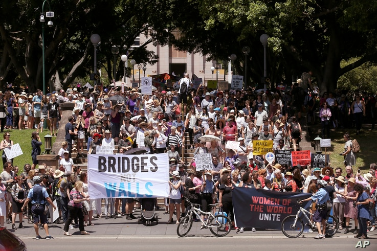 People gather at Hyde Park during the Women's March rally protesting the start of Donald Trump's presidency, in Sydney, Australia, Jan. 21, 2017.