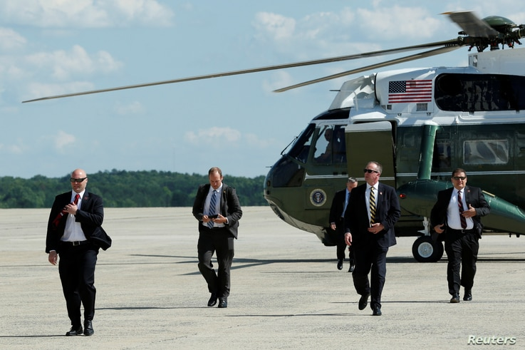 U.S. Secret Service agents arrive on a backup helicopter following President Donald Trump at Joint Base Andrews outside Washington, before his travel to Bedminister, New Jersey, June 9, 2017.